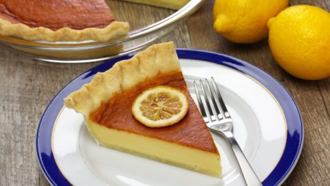 I slice of southern buttermilk pie on a plate with a fork.