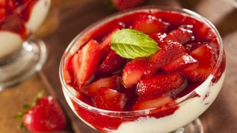 A glass of fresh strawberry parfait dessert.