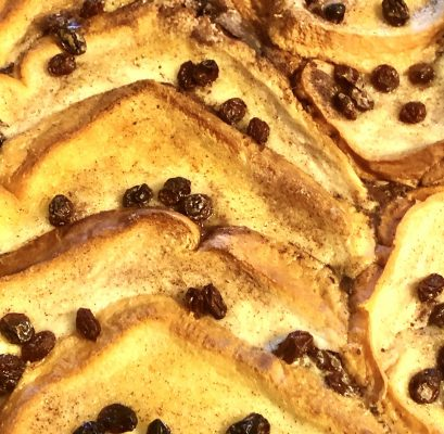 A close up of bread and butter pudding dessert.