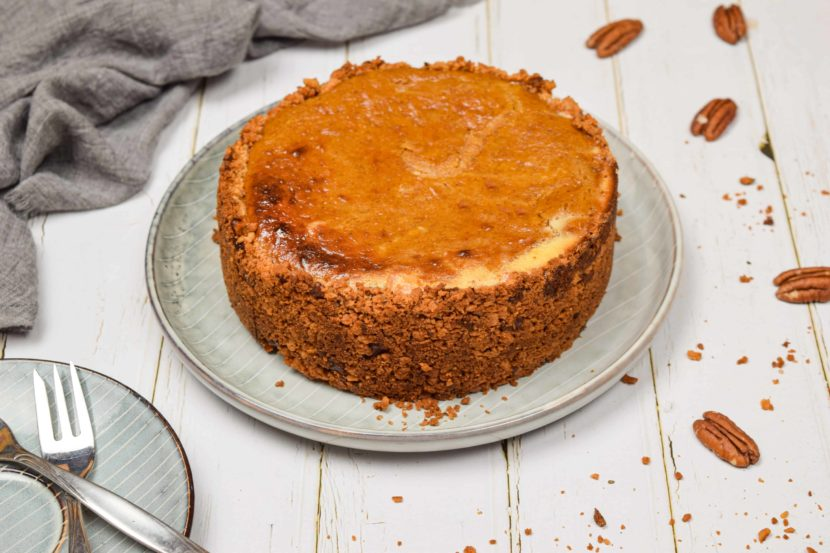 A gingersnap pumpkin cheesecake in a dish on the table.
